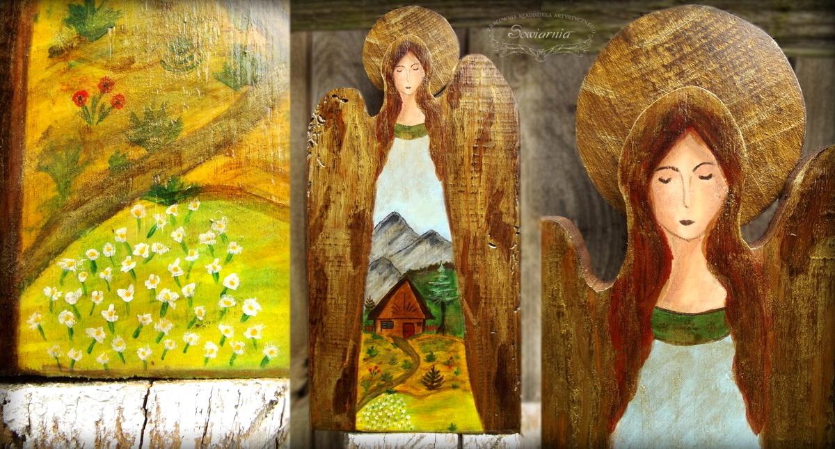 anioł z górskim krajobrazem