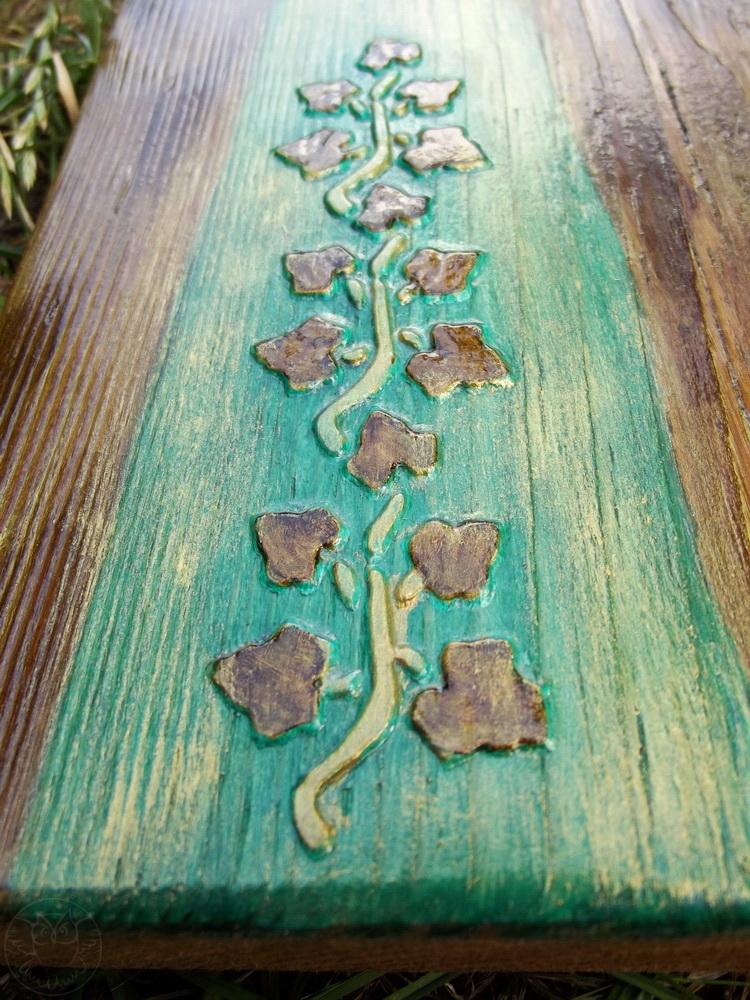drewniany anioł w morskiej zieleni