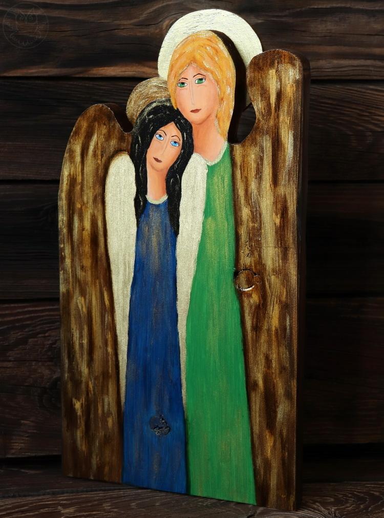siostrzany anioł na desce