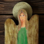 zielony anioł i stokrotki